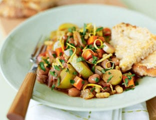 Garlicky vegetable, bean and herb pot with parmesan toasts