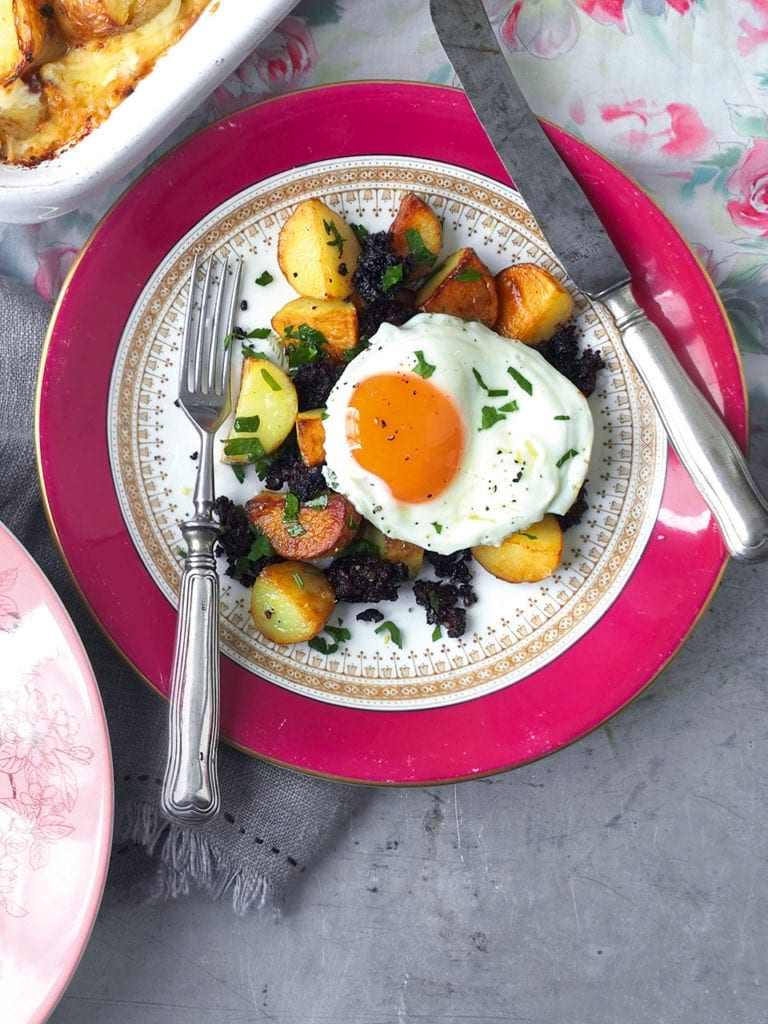 Sautéed jersey royals with black pudding and fried egg