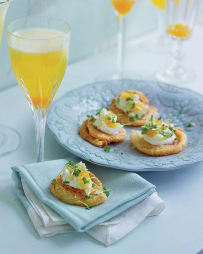 Cheese swirls with quail's eggs and cress