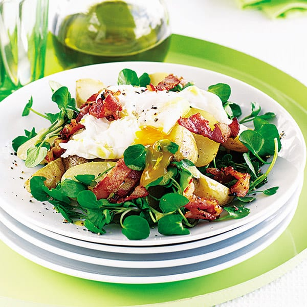 Poached egg and new potato salad with crispy bacon