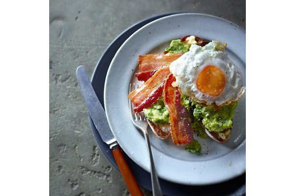 Avocado, bacon and fried egg on toast