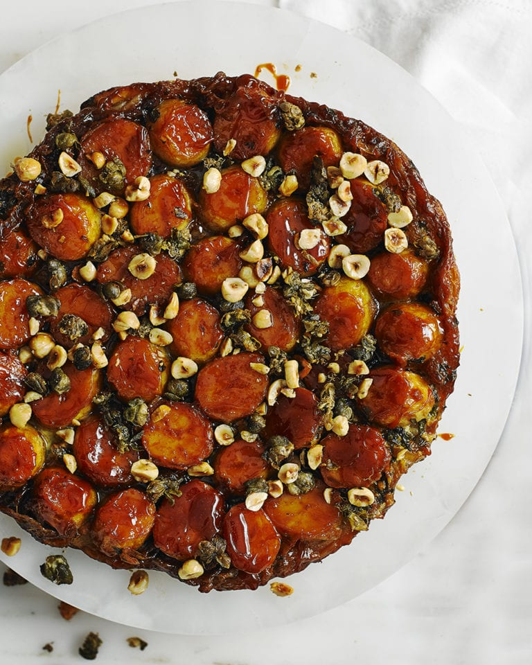 New potato and onion tarte tatin with crispy capers and hazelnuts