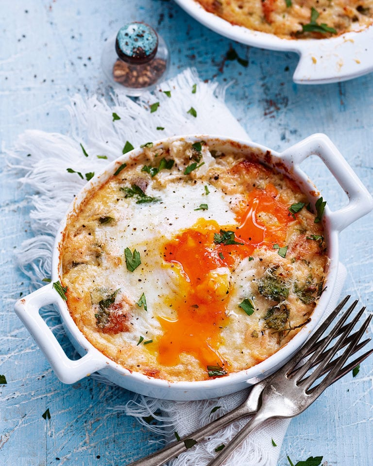 Baked eggs with hot-smoked salmon and herbs