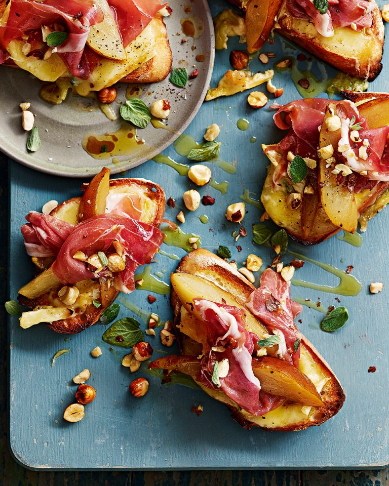 Fontina and cambozola on sourdough toasts with parma ham, roasted pears and hazelnuts - delicious. magazine