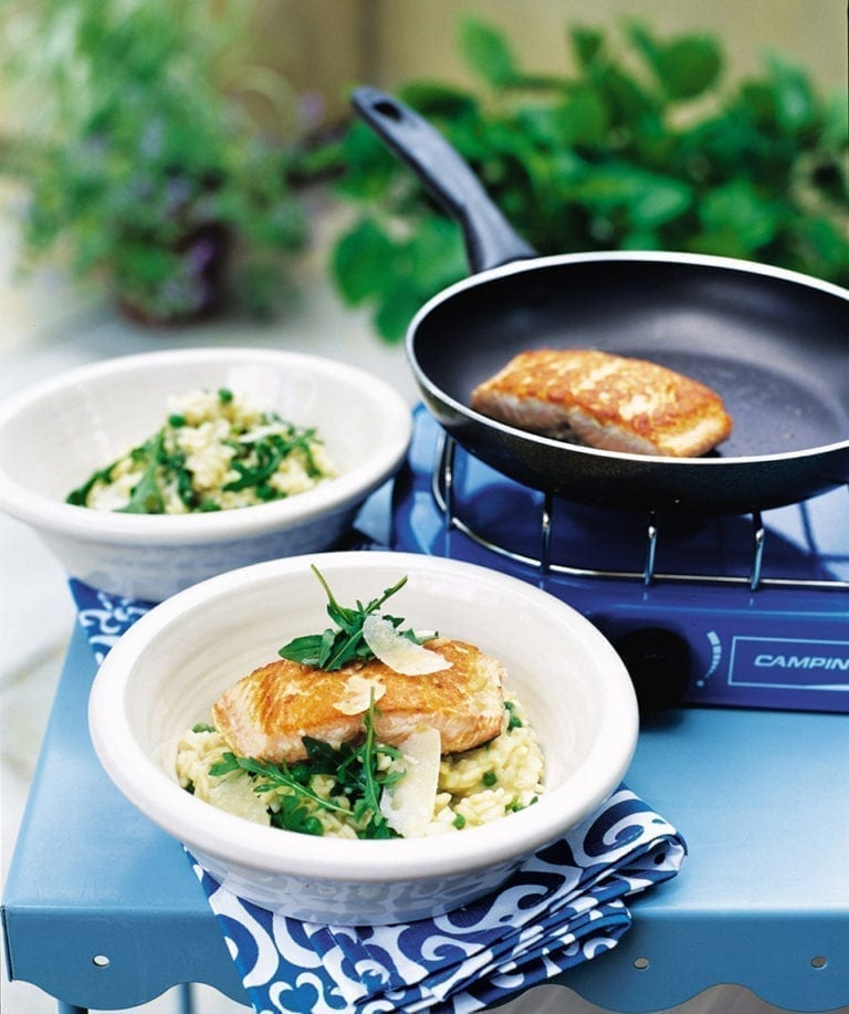 Lemony pea and rocket risotto with salmon steaks