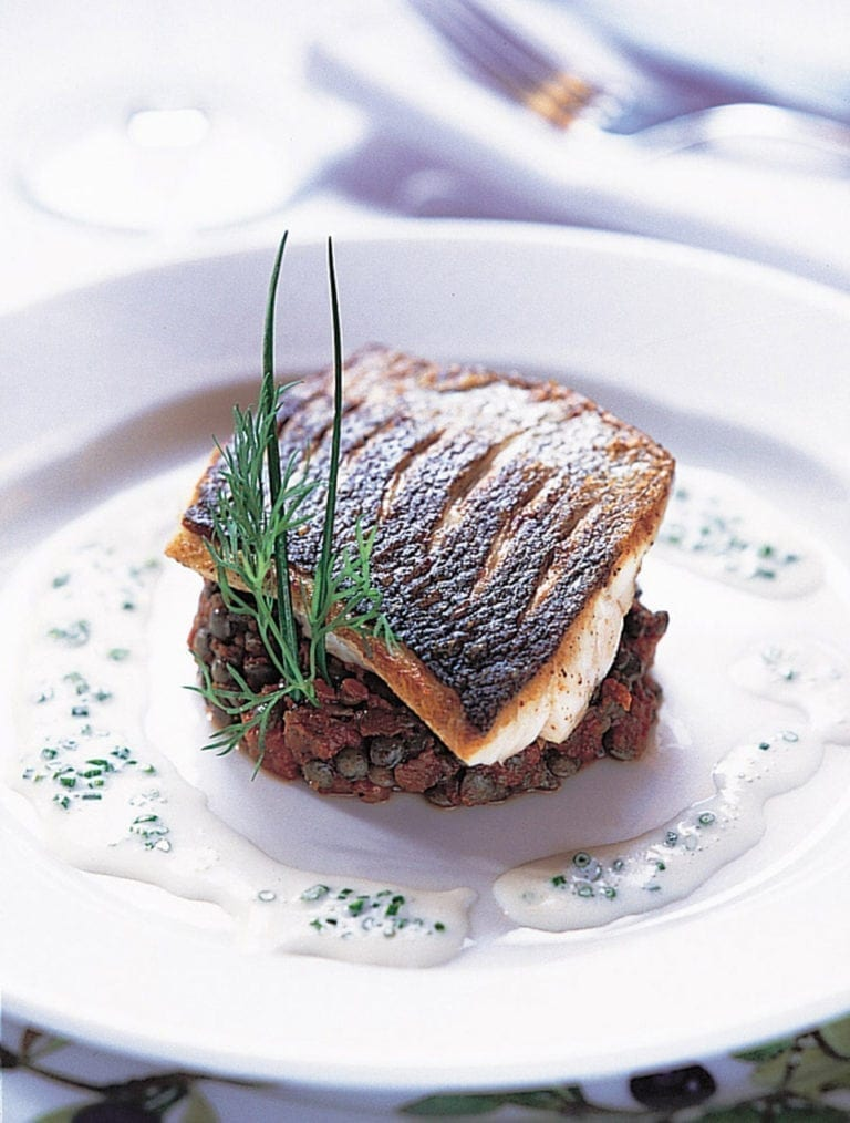 Fillets of sea bass on provençal lentils