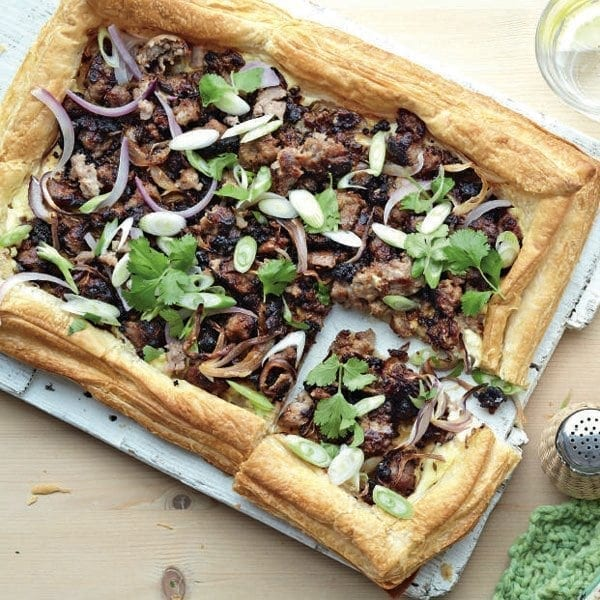 Spiced sausage and red onion tart