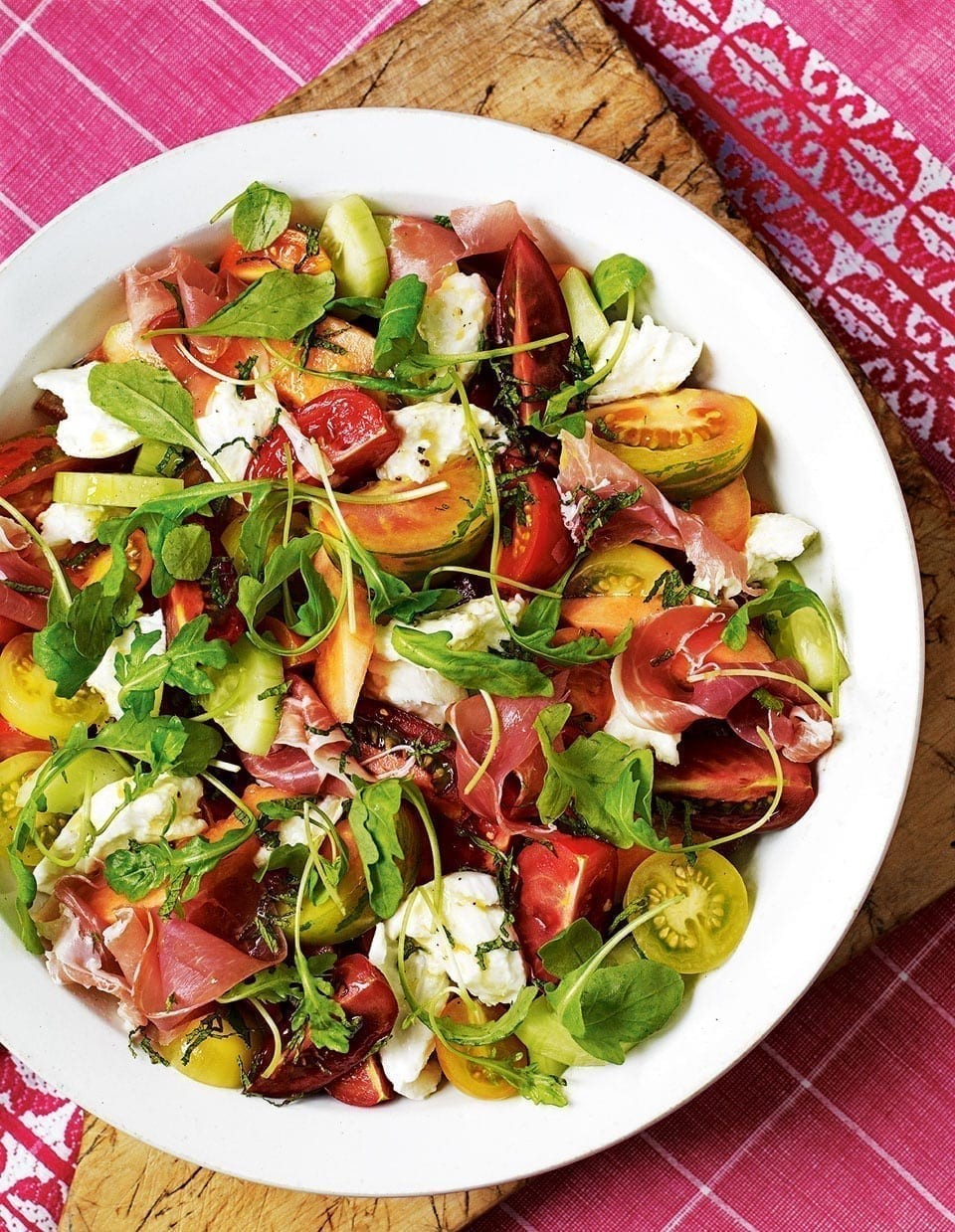 heritage tomato salad with air dried ham melon and