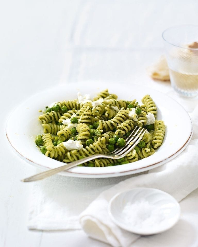 Walnut pesto pasta with peas and goat's cheese