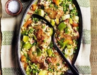Cider-braised chicken thighs with pearl barley, bacon, carrots and peas