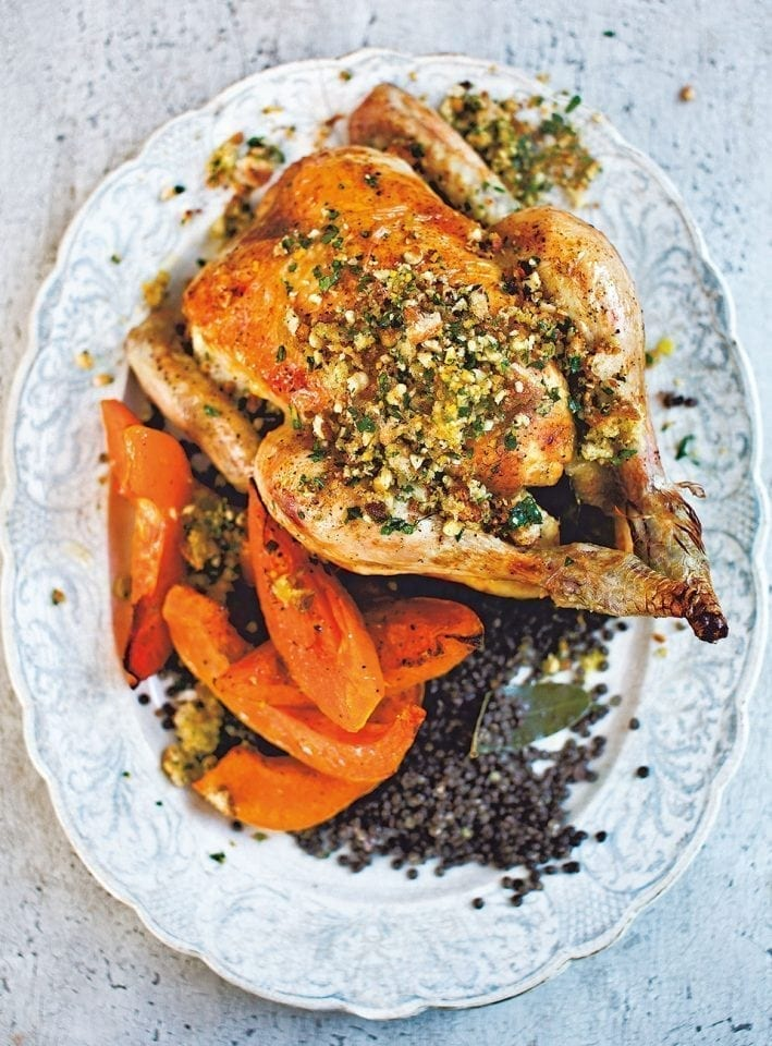 Roast chicken with squash, black lentils and hazelnut picada