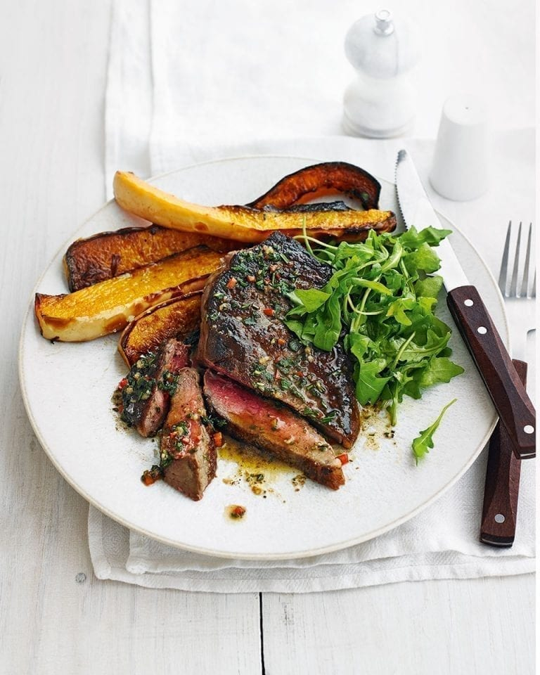 Sirloin steaks with roast squash and herb butter