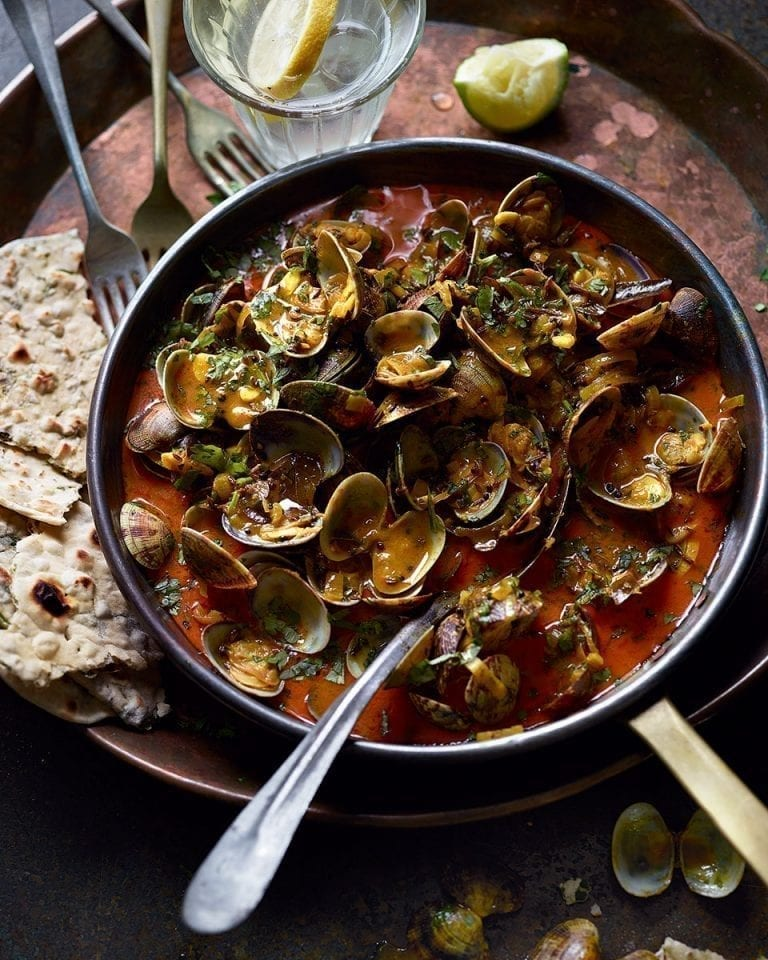 Keralan-style clams with herb-stuffed chapatis