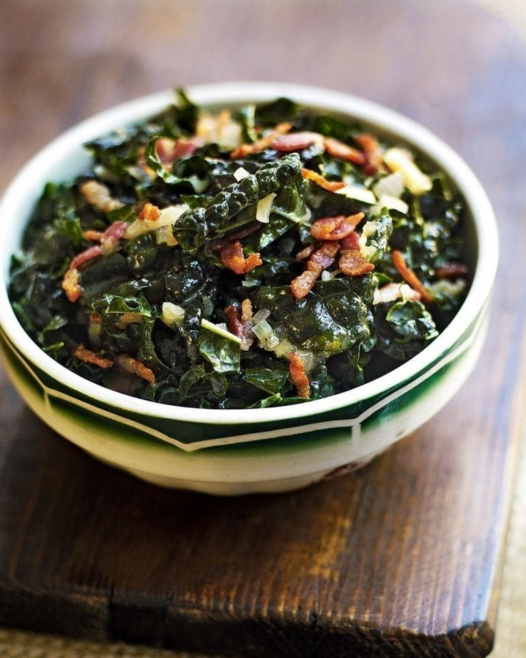 Winter greens with a hot bacon and mustard dressing