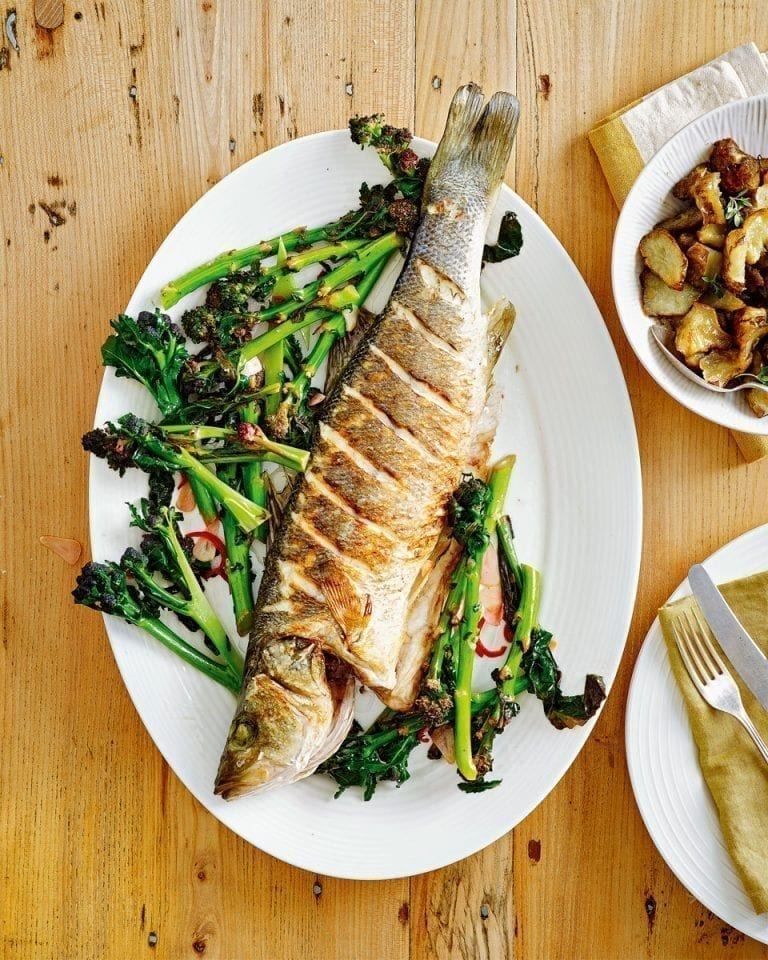 Whole sea bass with purple sprouting broccoli, chilli and garlic