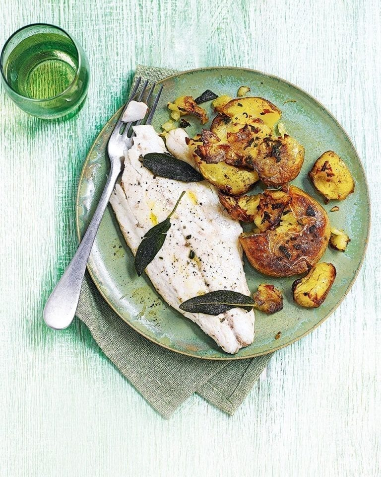 Garlic and sage smashed jersey royals with pan-fried sea bass
