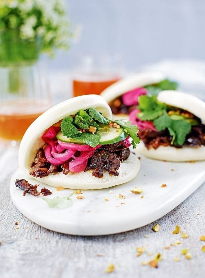 Steamed buns with orange & pomegranate glazed lamb
