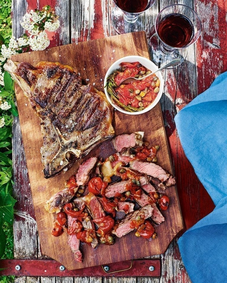T-bone steaks with tomato, caper and rosemary sauce