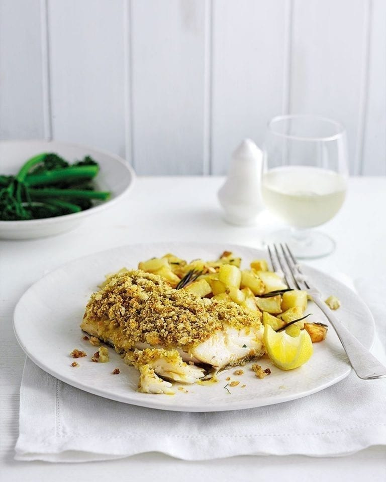 Pesto-crusted cod with garlic roast potatoes