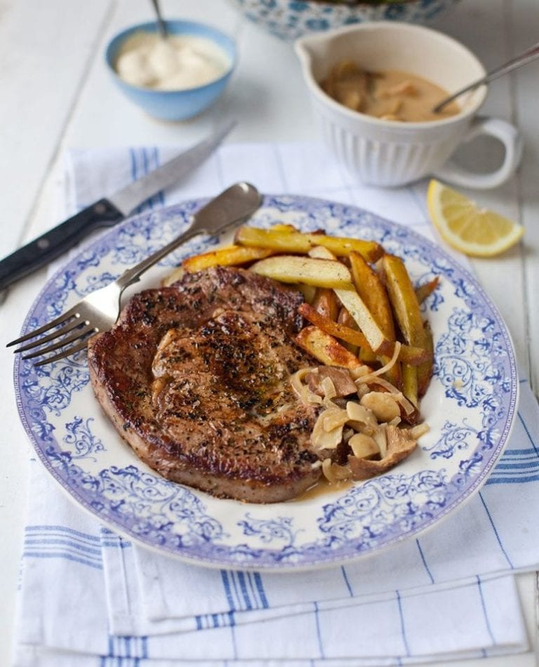 Ultimate steak and chips with a rich mushroom sauce
