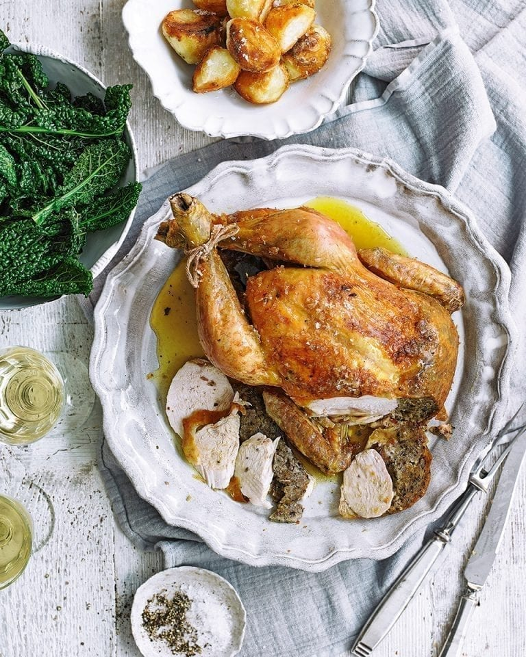 Roast chicken with lemon, oregano and olive breadcrumb stuffing