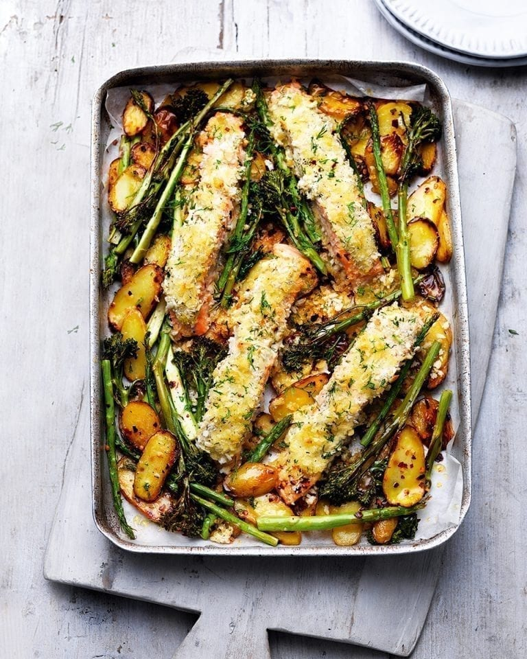 Tray-roast salmon and vegetables with crème fraîche and crumbs
