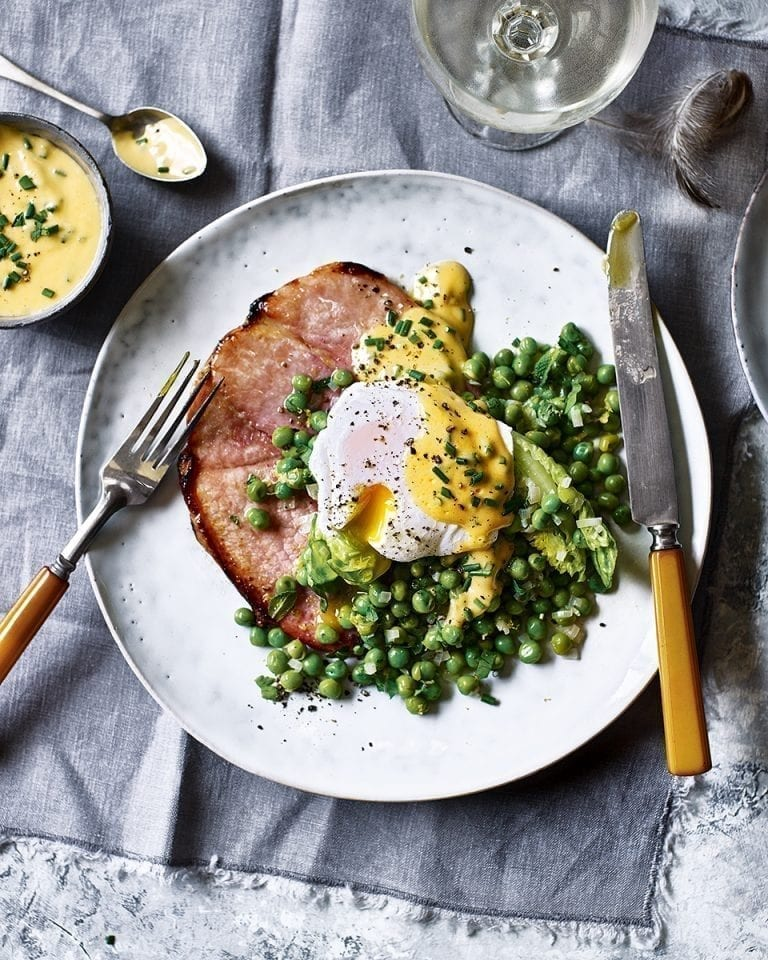 Grilled gammon steaks with peas, herb hollandaise and poached eggs