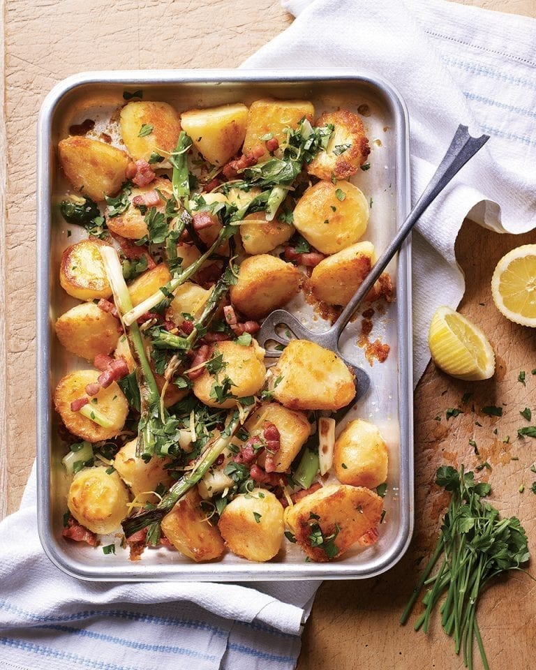 Golden roasties with bacon, spring onions, lemon and parsley