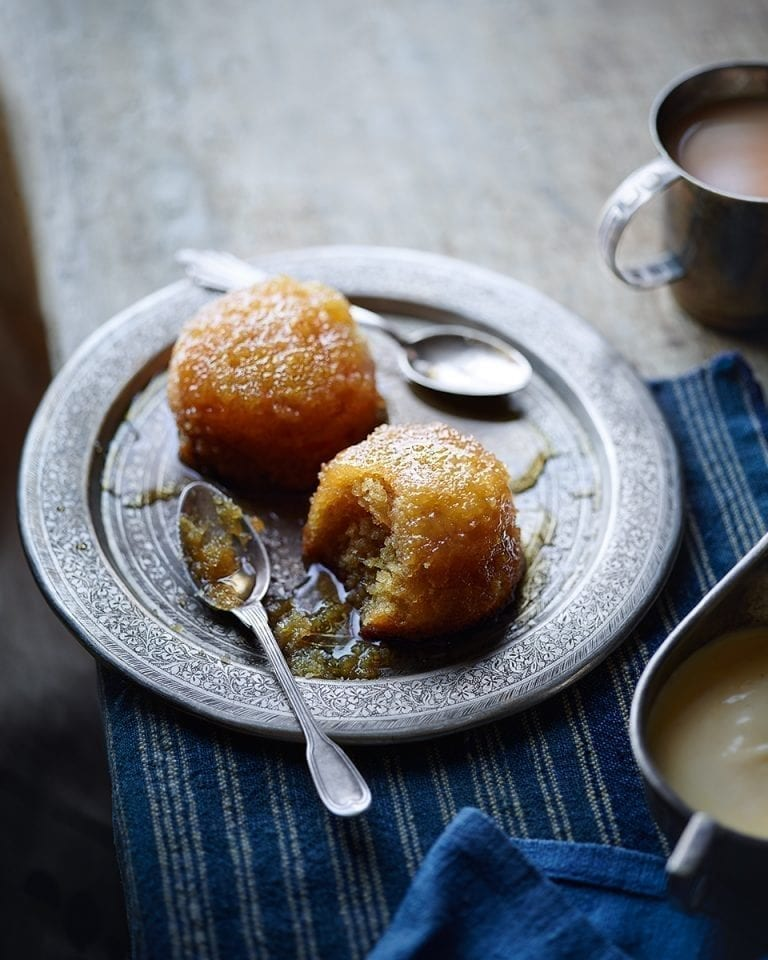 Baked lemon curd syrup sponges with brandy custard