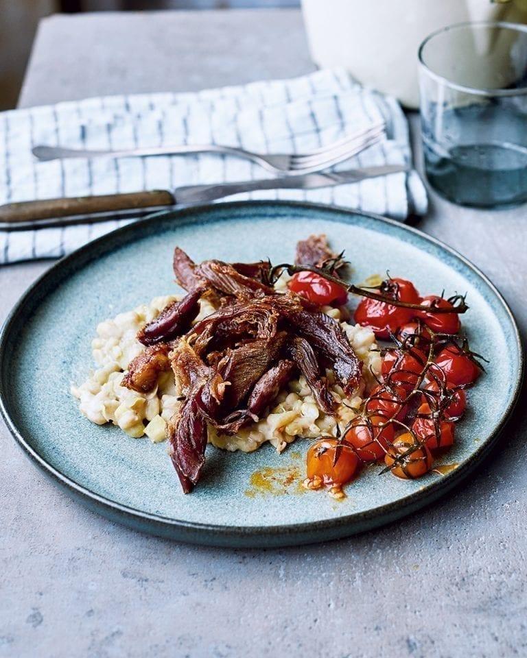 Crispy lamb with lemony flageolet beans and roast tomatoes
