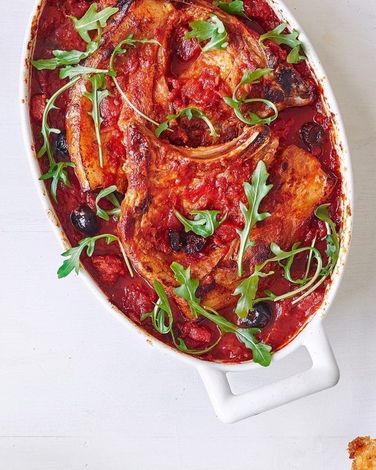Pork chops baked in chorizo and black olive tomato sauce