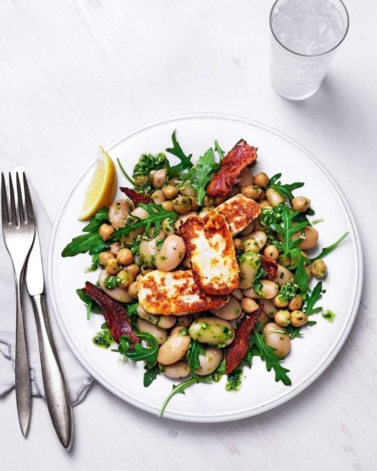 Warm pesto, chickpea and butter bean salad with halloumi