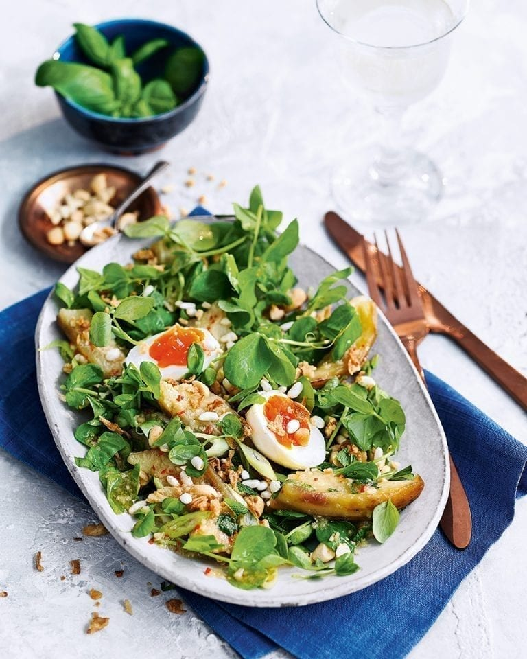 Spicy aubergine salad with peanuts, herbs and egg