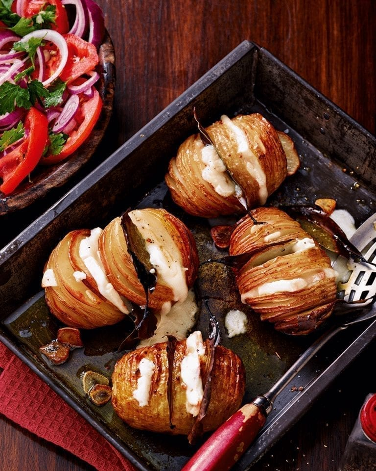 Bay and garlic studded hasselbacks with taleggio
