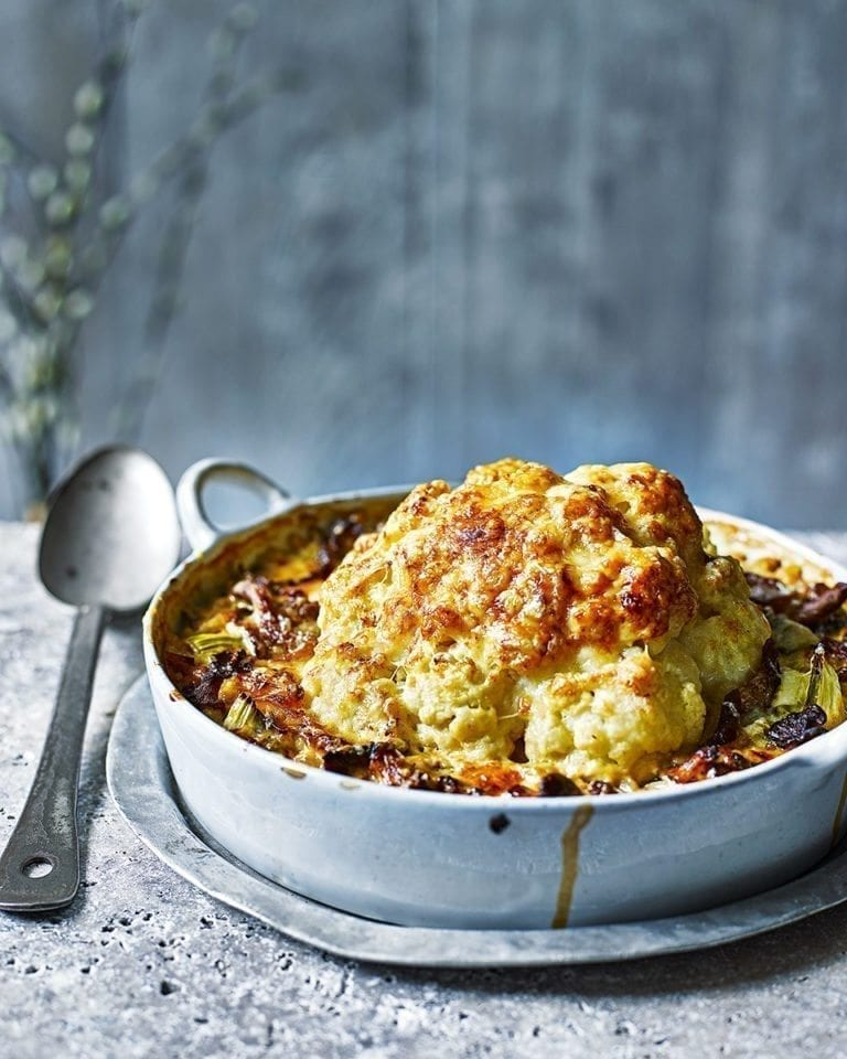 Whole baked cauliflower with pearl barley, wild mushrooms and cheese