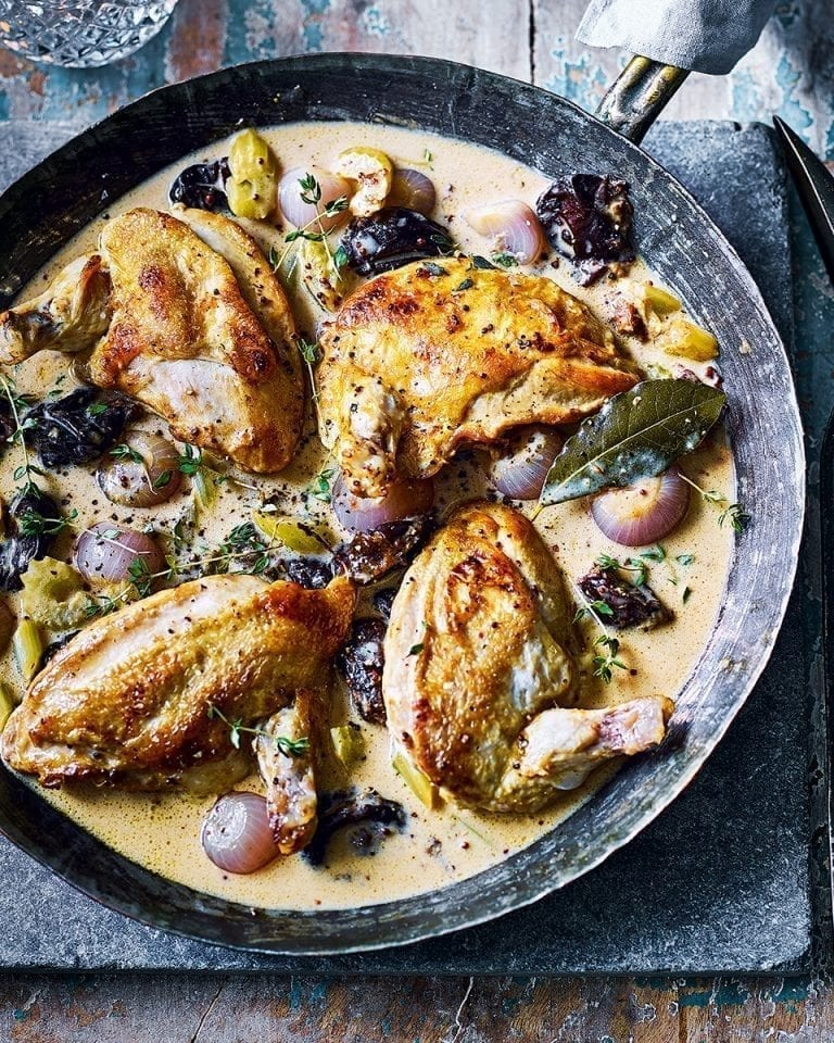 Pan-fried chicken supremes in mustard, cream and prune sauce