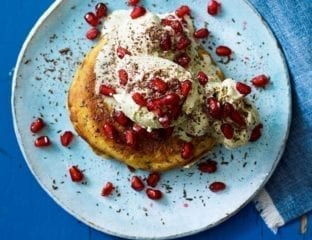 Pancake waffles with ice cream and pomegranate