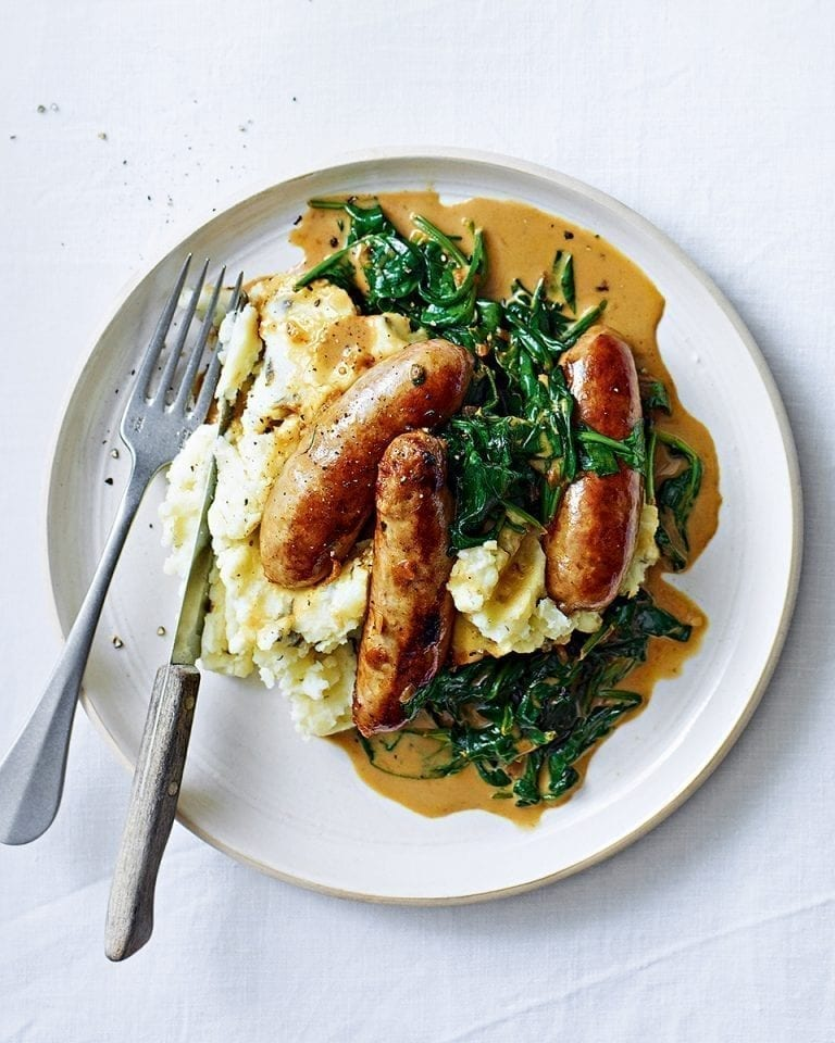 Sausages with creamy spinach sauce and garlic and caper mash