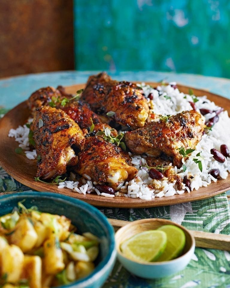 Jerk chicken with coconut rice and peas and pineapple salsa