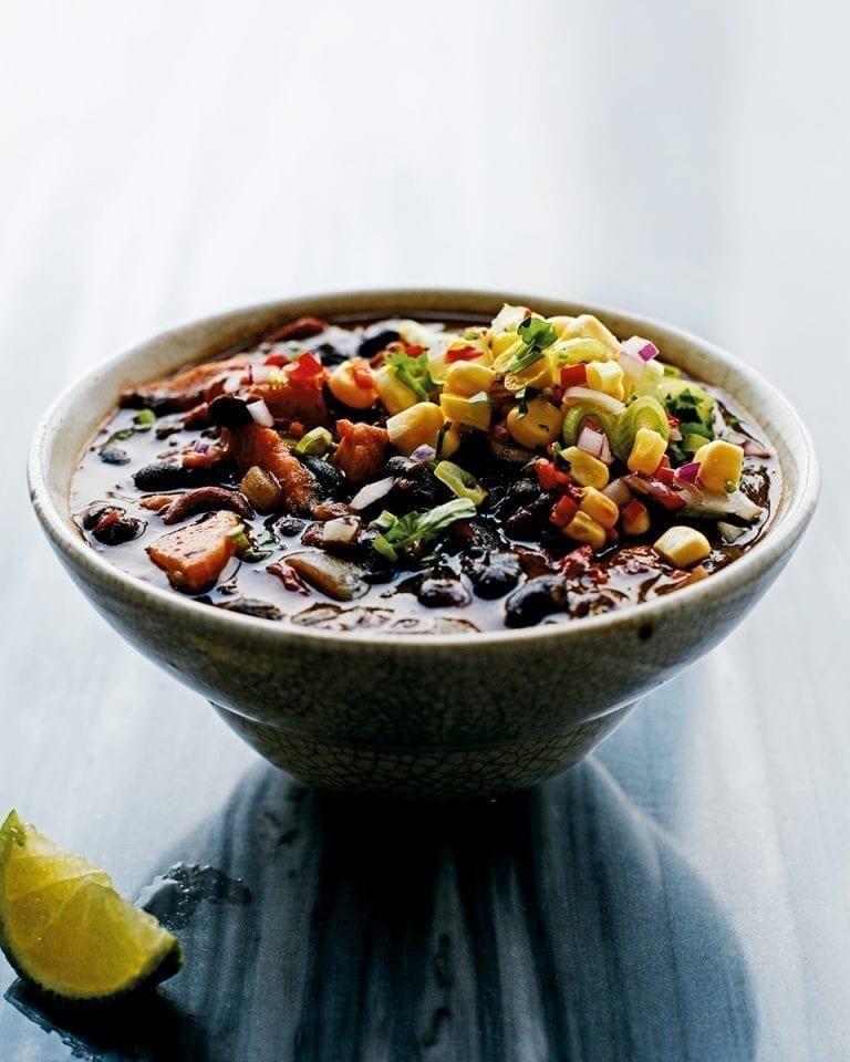 Brazilian black bean soup with raw corn salsa