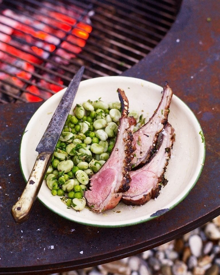 Barbecued rack of mutton with broad beans, peas and lovage