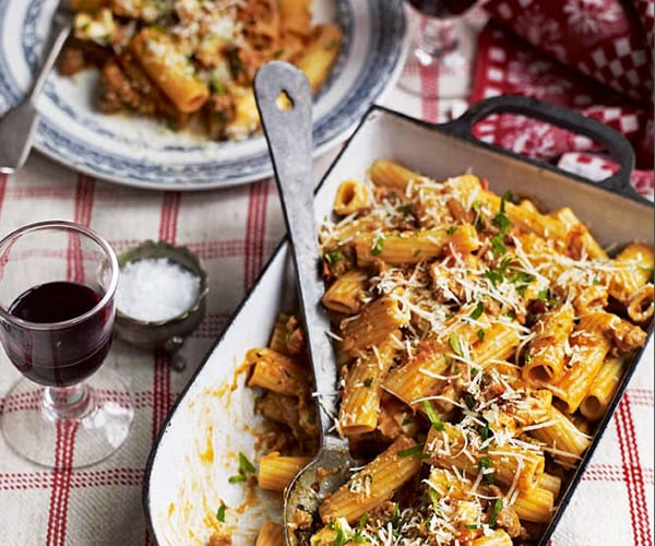 sausage ragu pasta topped with cheese image