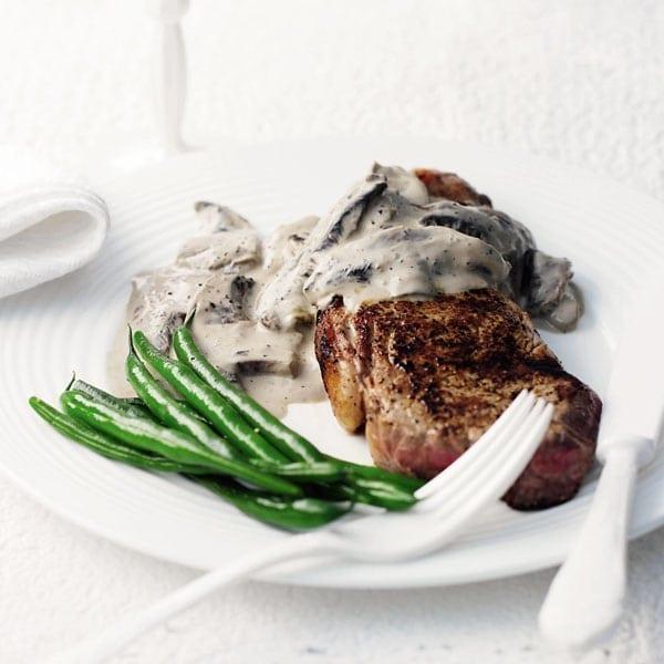 Rump steak with mushroom and peppercorn sauce