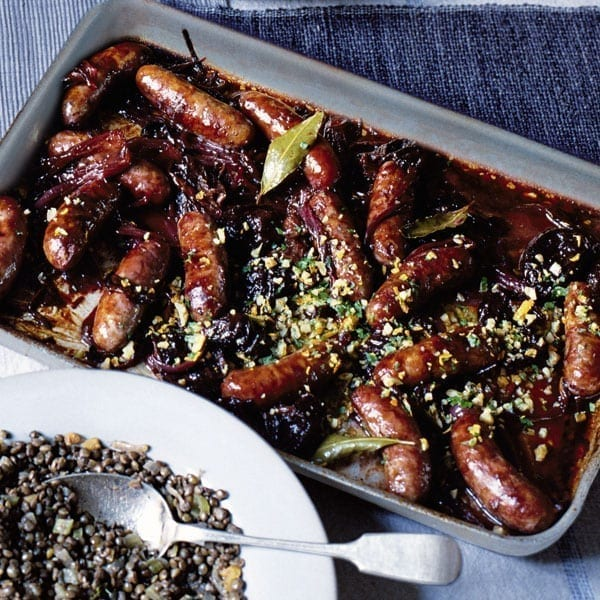Baked sausages with prunes and walnut gremolata