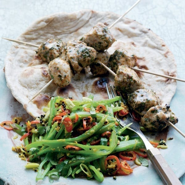 Gujarati-style runner beans with spiced chicken skewers