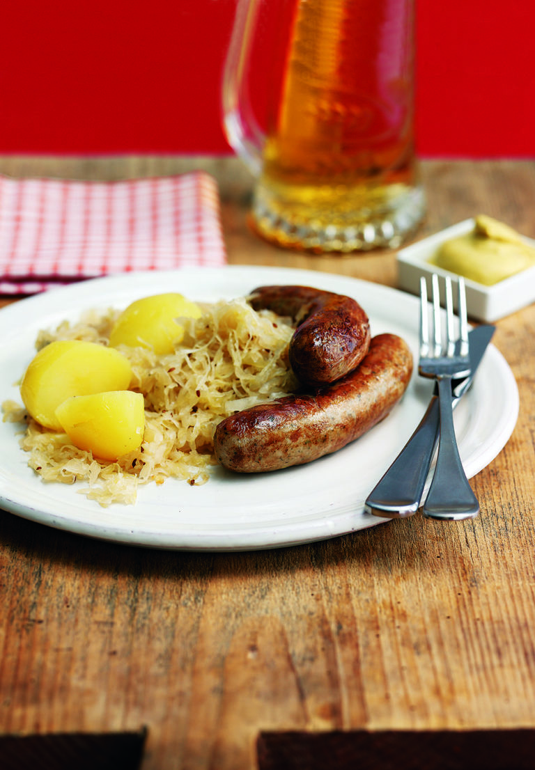 Sauerkraut cooked in Riesling with apples and sausages