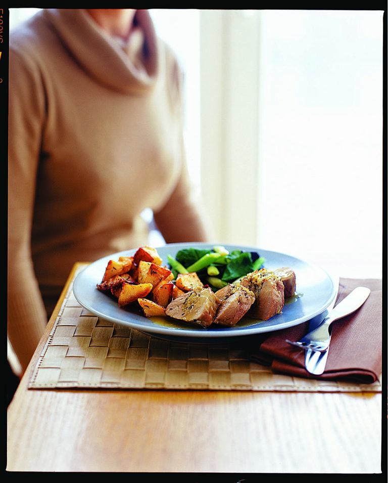 Roast pork stuffed with orange and thyme