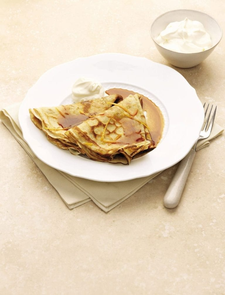 Crepe suzettes on a white plate