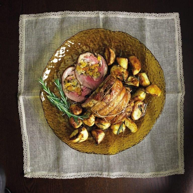 Apricot stuffed lamb shoulder with rosemary roast potatoes