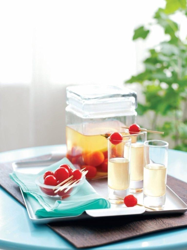 Vodka cherry tomatoes with iced vodka shots